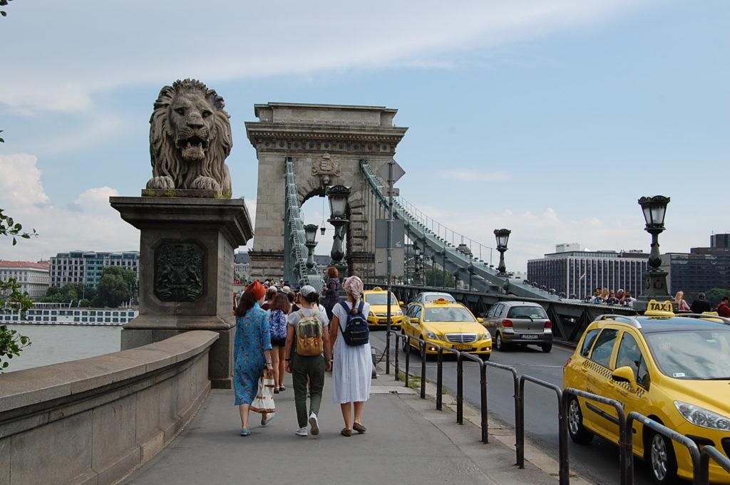 walking over chain bridge